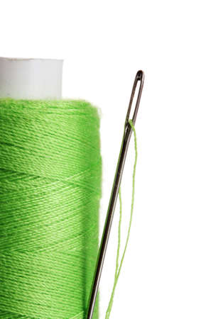 bobbin: Green bobbin with needle isolated on white