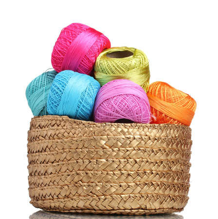 made to measure: Bright threads for knitting in the basket isolated on white Stock Photo