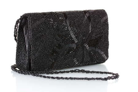 embroidered: Black clutch embroidered with beads isolated on white