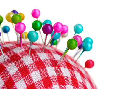 pinhead: Colored pinheads in pin-cushion isolated on white Stock Photo