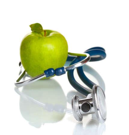hospital background: Medical stethoscope and green apple isolated on white Stock Photo
