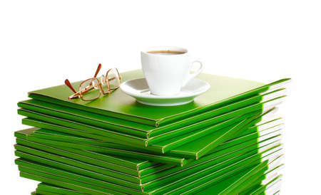 Many green folder with cup of coffee isolated on white Stock Photo - 11407149