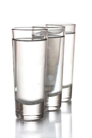 Three glass of vodka isolated on white photo