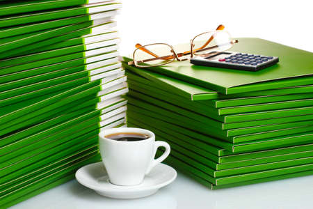 Many green folder with cup of coffee closeup Stock Photo - 11493599