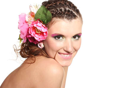 Beautiful girl with flowers in her hair isolated on white photo