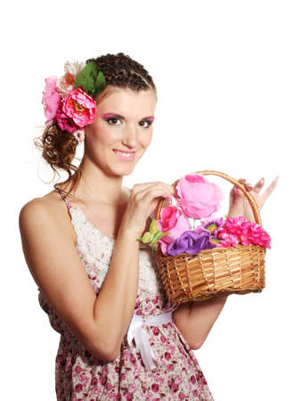 Beautiful girl with flowers in her hair and with a basket of flowers isolated on white photo
