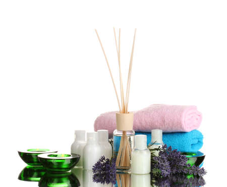 Bottle of air freshener, lavander, towels and candles isolated on white photo