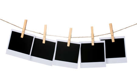 hanging: Photo paper hanging on the clothesline isolated on white