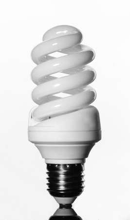 saving electricity: Energy saving lamp isolated on white