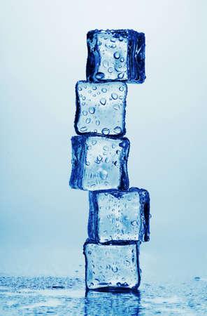 ice blocks: Melting ice cubes isolated on white Stock Photo
