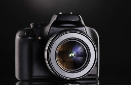 photocamera: Black photocamera on black background
