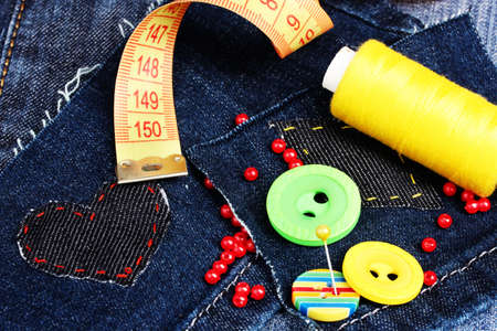 Heart-shaped patch on jeans with threads and buttons closeup Stock Photo - 11637509