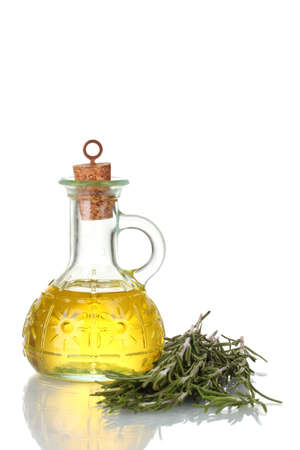 Oil in a bottle and fresh rosemary isolated on white Stock Photo - 11634969