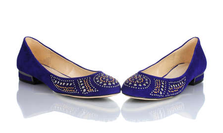 flat foot: Elegant blue flat shoes for women in stones isolated on white Stock Photo