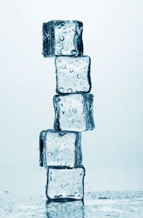 Melting ice cubes isolated on white photo