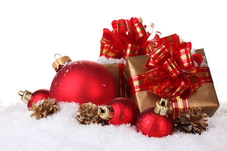 beautiful red Christmas balls, gifts and cones on snow isolated on white photo