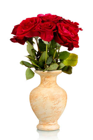 vase: Beautiful red roses in a vase isolated on white