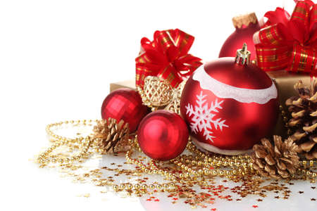 beautiful red Christmas balls, gifts and cones isolated on white photo