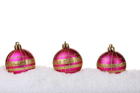 beautiful pink Christmas balls in snow isolated on white photo