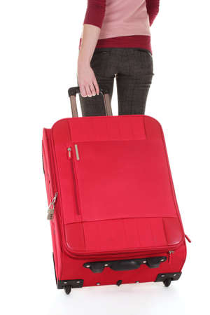 traveller with a suitcase isolated on white photo