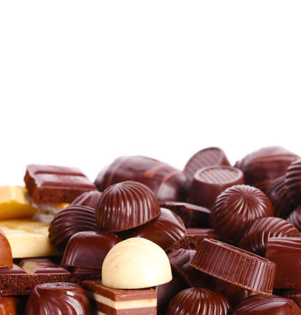 Many different chocolate candy isolated on white photo
