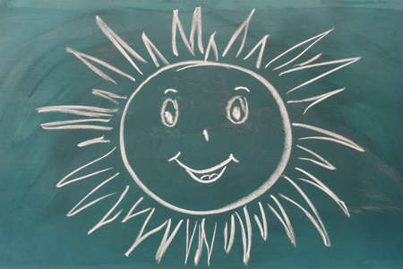 Blackboard with drawing smiling sun closeup Stock Photo - 11634282
