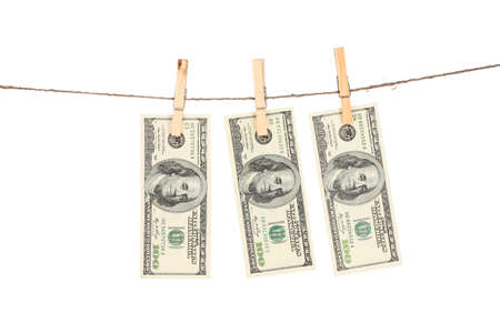 Three one hundred dollar bills is hanging on a rope with wooden clothespin isolated on white photo
