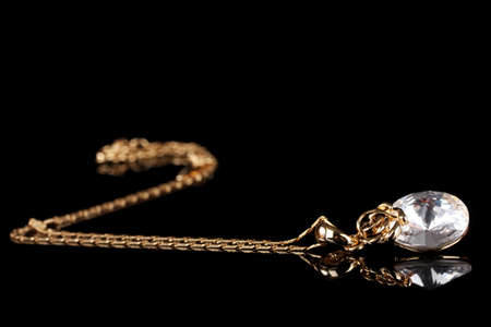pendant: beautiful gold necklace with gem on black background Stock Photo