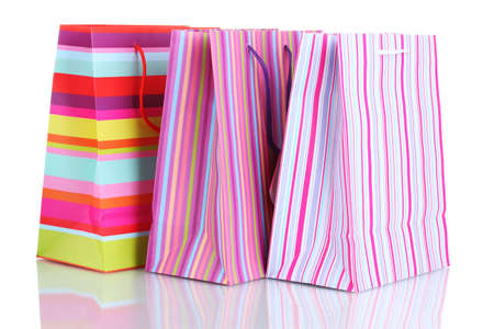 bright gift bags isolated on  white photo