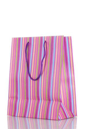 Striped gift bag isolated on white photo