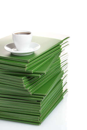 Many green folder with cup of coffee isolated on white Stock Photo - 11668894