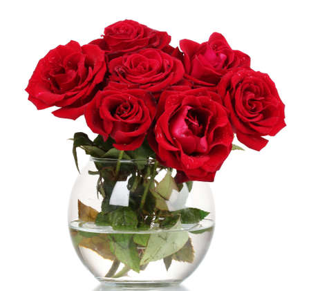 vase color: Beautiful red roses in a vase isolated on white