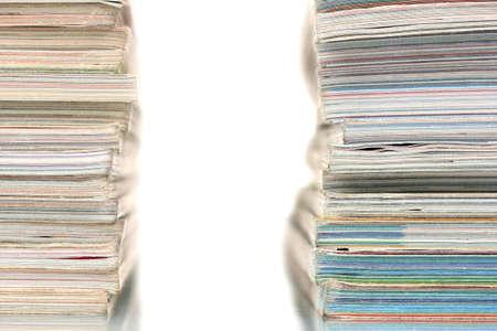 two stacks of magazines isolated on white photo