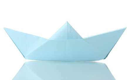 Origami boat out of the blue paper isolated on white photo