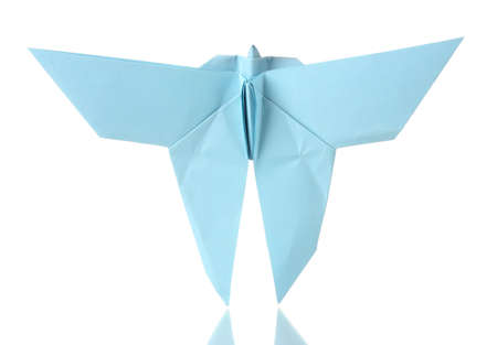 Origami butterfly  out of the blue paper isolated on white photo
