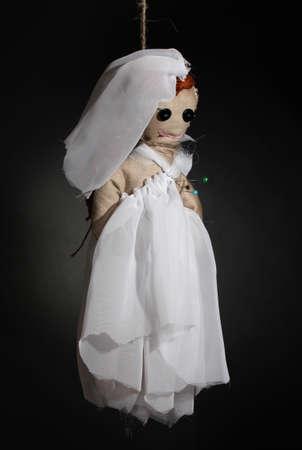 hanged woman: Hanged doll voodoo girl-bride  on grey background