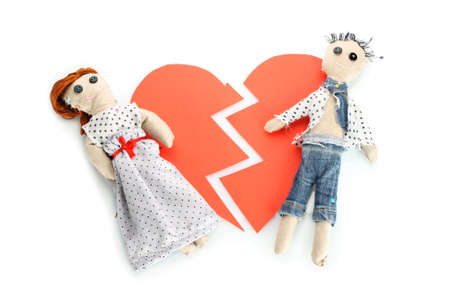 Two voodoo dolls boy and girl on the broken heart isolated on white Stock Photo - 11715638