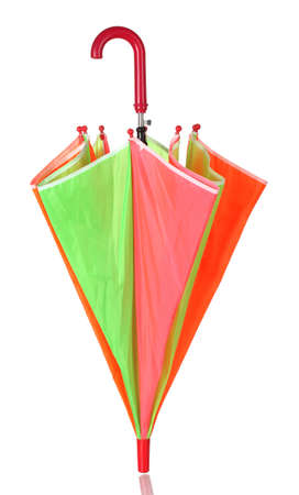 Closed multi-colored umbrella isolated on white photo