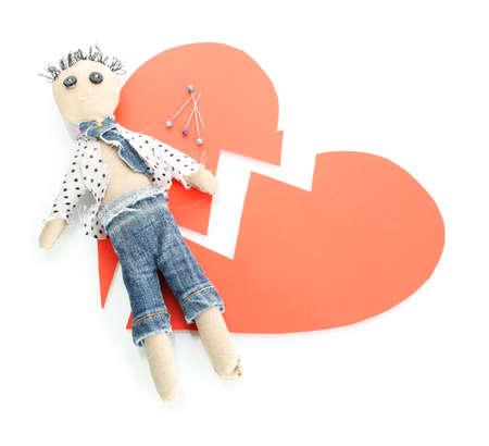 Voodoo doll boy on the broken heart isolated on white photo