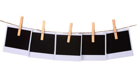 Photo paper hanging on the clothesline isolated on white photo