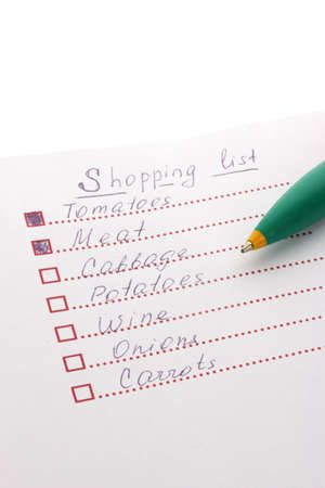 Shoping list and pen closeup photo