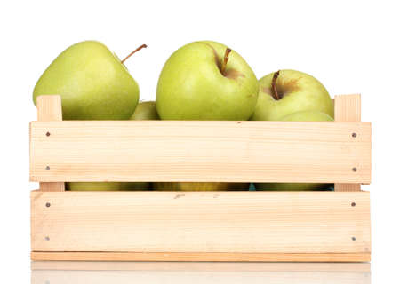juicy green apples in a wooden crate isolated on white photo