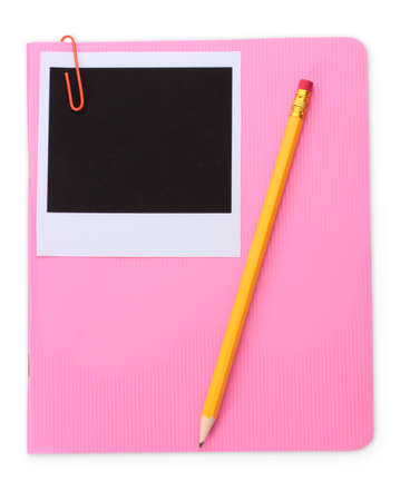 Photo paper and pink notebook isolated on white photo