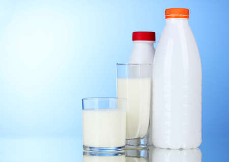 Tasty milk in glasses and bottle on blue background Stock Photo - 11757765