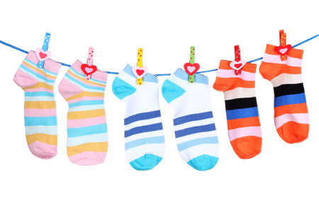 Bright striped socks on line isolated on white