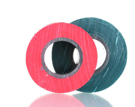 Red and green insulating tapes isolated on white background. photo