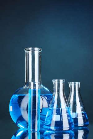 Test-tubes on blue background photo