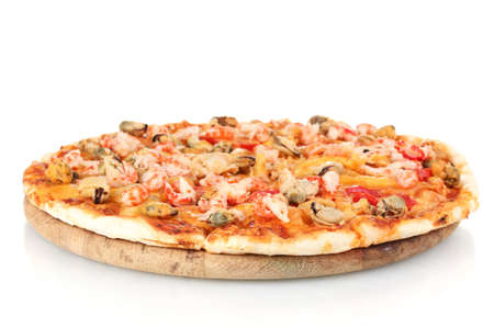 Delicious pizza with seafood on wooden stand isolated on white photo
