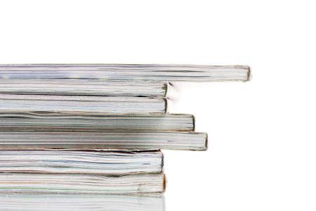 stack of magazines isolated on white photo