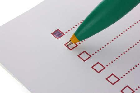 Checklist and pen closeup photo
